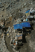 Gold miner's familly in the shack above their tunnel on the hillside. Mount Diwata, Mindanao. The Philippines