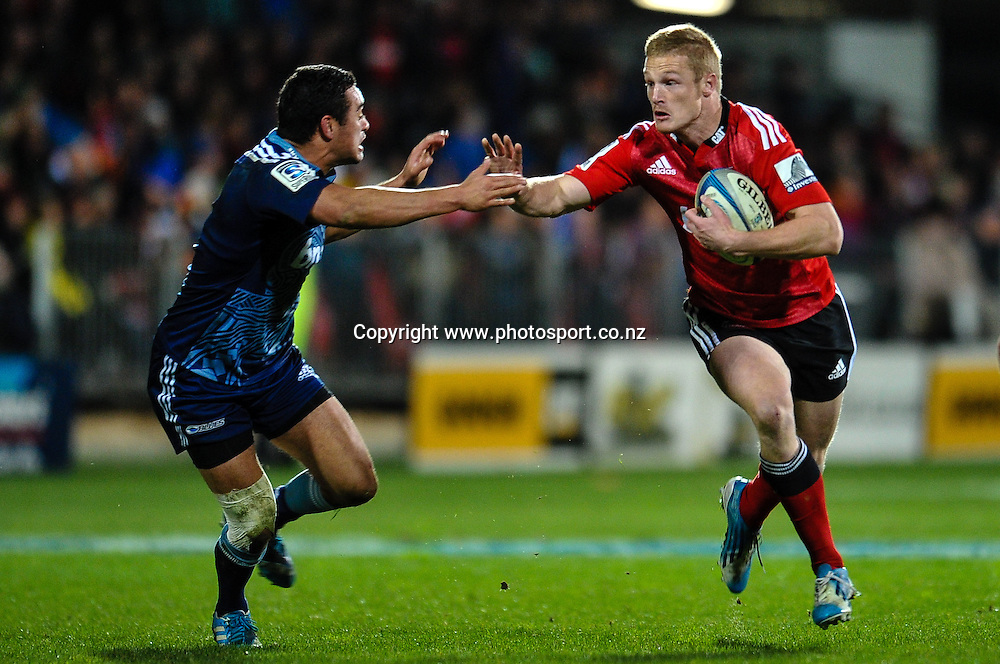 Johnny McNicholl of the Crusaders fends off Bryn Hall of the Blues in the Super rugby match,  Crusaders v The Blues, at AMI Stadium, Christchurch, on the 5 July 2014 . Photo:John Davidson/www.photosport.co.nz