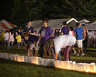 Pine Bush, New York - People from the Pine Bush community participate in the Relay for Life on Saturday, June 12, 2010. While some participants walk, others light the candles in paper bags that line the track. Luminaries are purchased in memory of someone who lost their battle against cancer, or in honor of a survivor of the disease.