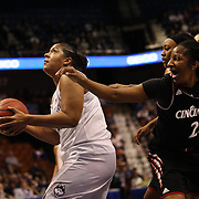 Kaleena Mosqueda-Lewis, UConn, drives to the basket while challenged by Jasmine Whitfield, Cincinnati, during the UConn Vs Cincinnati Quarterfinal Basketball game at the American Women's College Basketball Championships 2015 at Mohegan Sun Arena, Uncasville, Connecticut, USA. 7th March 2015. Photo Tim Clayton