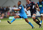 Tevita Li breaks away during a pre season Super Rugby match between the Blues v Storm, Pakuranga Rugby Club, Auckland, New Zealand. Thursday 4 February 2016. Copyright Photo: Andrew Cornaga / www.Photosport.nz