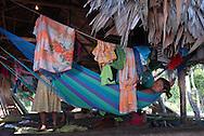 Comunidad Warao de Boca de Tigre  en el Delta Amacuro, Venezuela. Este pueblo indígena del oriente del país,  que contaba para 2001 con 36.000 habitantes aproximadamente, construyen sus hogares suspendidos sobre las aguas  para compensar los cambios de marea que vienen del mar del Caribe. Durante los años recientes conviven con la exploración petrolífera, el tráfico de drogas y la actividad turistica se lleva a  cabo actualmente en la zona, en la que habitan desde hace por lo menos 8.000 años. Venezuela,  2006. (Ramón Lepage / Orinoquiaphoto)   Warao Community in Boca de Tigre in the Amacuro Delta, Venezuela. This ethnic group of the east of the country, that counted in 2001 with approximate 36.000 inhabitants, constructs their homes suspended on waters to compensate the changes of tide that come from the Caribbean sea. During the recent years they coexist with the petroliferous exploration, the drug traffic and the tourist activity that  are carried out in the zone, in which they have been living for at least 8,000 years. Venezuela, 2006. (Ramon Lepage/Orinoquiaphoto)..