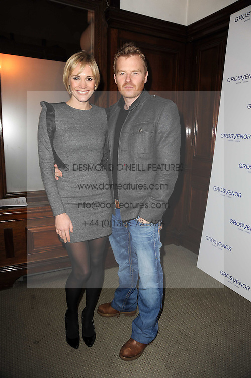 JENNI FALCONER and JAMES MIDGLEY at the launch of Grosvenor Shirts luxury collection to celebrate the 2010 FIFA World Cup in South Africa held at 88 St.James's Street, London SW1 on 8th December 2009.