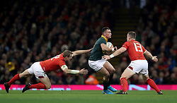 South Africa's Jesse Kriel (centre) and Wales' Hadleigh Parkes (left) and Scott Williams during the Autumn International at the Principality Stadium, Cardiff.