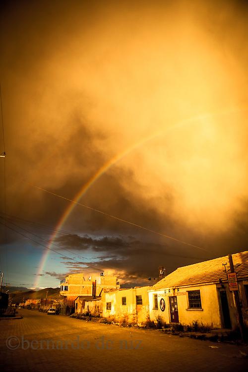 A rainbow is seeing trough the sand storm in Uyuni,  the world's largest salt flat, Salar de Uyuni in Bolivia. Photographer: Bernardo De Niz