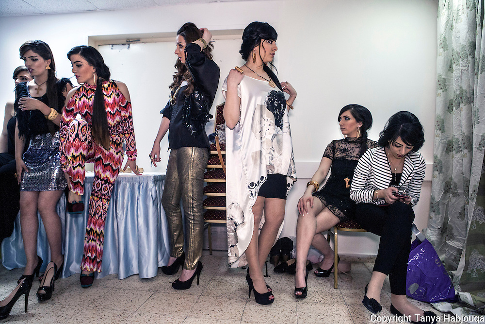 Young ladies model in a fashion show at the Intercontinental Bethlehem for upcoming designer Nadya Hazbunova.