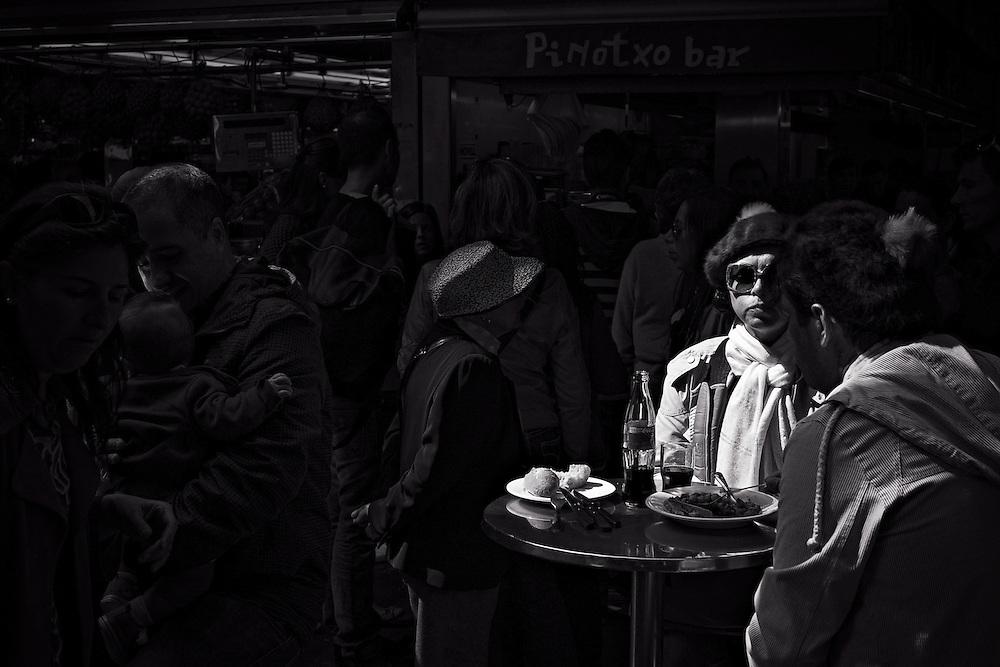 Woman eating at Boqueria market, Barcelona.