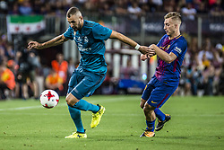 August 13, 2017 - Barcelona, Catalonia, Spain - Real Madrid forward BENZEMA competes with FC Barcelona forward DEULOFEU for the ball during the Spanish Super Cup Final 1st leg between FC Barcelona and Real Madrid at the Camp Nou stadium in Barcelona (Credit Image: © Matthias Oesterle via ZUMA Wire)