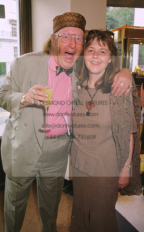 MR & MRS JOHN McCRIRICK he is the racing pundit, at a reception in London on 13th July 1999.MUE 31