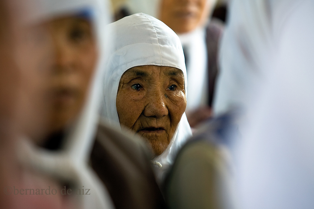 Chinese muslims woman study in a very small courtyard in the Dujia Tan Mosque in northwest China's Ningxia Hui Autonomous Region, China, on Thursday, September. 11, 2008. The islam is the second biggest religion in China, where there are between 20 and 30 millions of muslims.