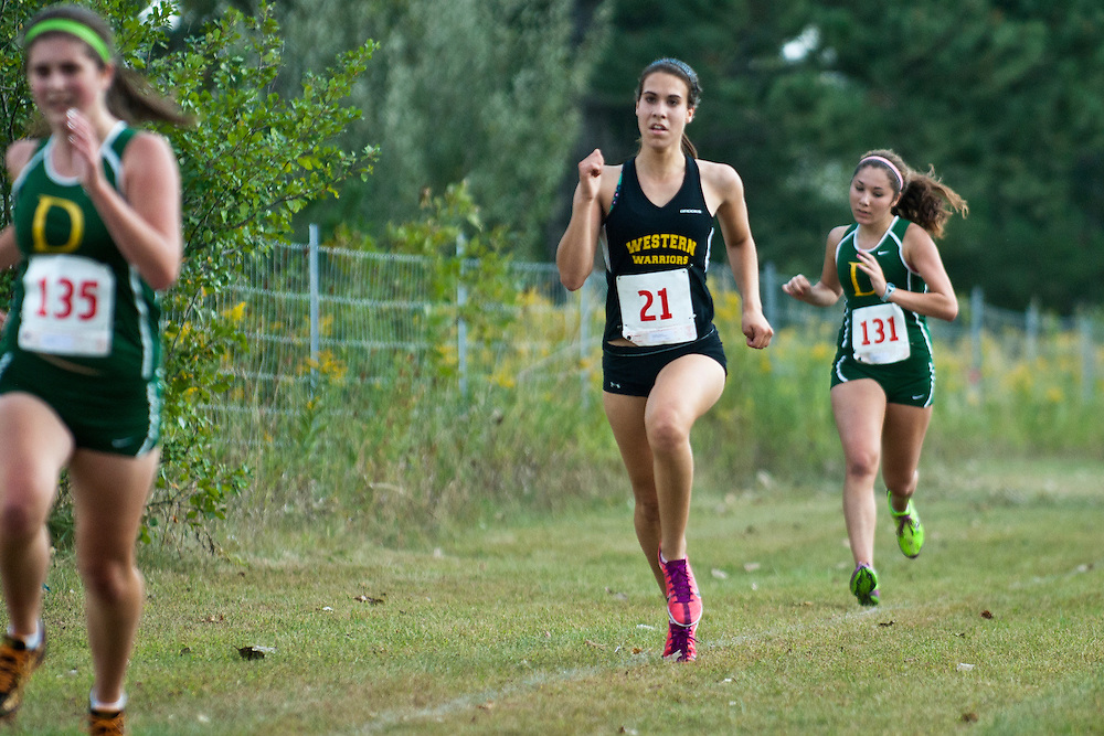 Lathan Goumas | The Bay City Times..Natasha Schlatter of Bay City Western High School during a cross country race at Stratford Woods Park in Midland, MI., on Tuesday September 13, 2011.