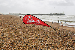 © Licensed to London News Pictures. 10/08/2019. Brighton, UK. Danger warning flags have been placed on the beach in Brighton and Hove as strong gusts of wind and powerful waves are hitting the seaside resort. Photo credit: Hugo Michiels/LNP