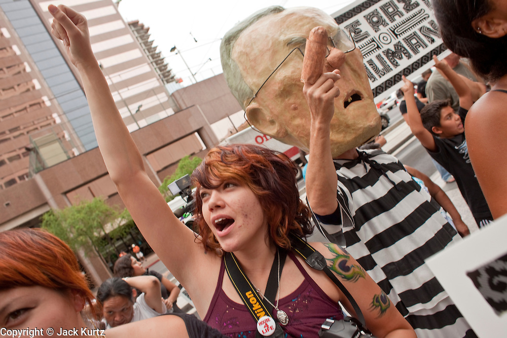 """19 JUNE 2009 -- PHOENIX, AZ: Diane Ovalle (CQ) from Phoenix, demonstrates against Sheriff Joe Arpaio Friday. The Sheriff's Department is headquartered in the Wells Fargo Bank building. Rev. Al Sharpton was in Phoenix Friday to protest the high profile """"crime suppression"""" sweeps conducted by the Sheriff's Department. Critics contend the sweeps use racial profiling to target Hispanics. PHOTO BY JACK KURTZ"""
