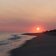 A beach scene at sunset in the height of summer on Cisco Beach, Nantucket, Nantucket Island, Massachusetts, USA. Photo Tim Clayton