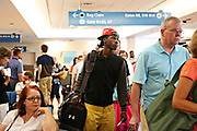 MELISSA LYTTLE   |   Times<br /> Dontrell &quot;Fred&quot; Johnson boards his plane at Palm Beach International Airport. Fred had never left Florida before or been on an airplane, until this day -- when he left for college in Iowa Falls, Iowa. &quot;I'm nervous, but ready,&quot; he told his mom as they parted ways.