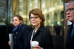 © London News Pictures. 05/03/2013 . London, UK.  Vicky Pryce (centre) arriving at Southwark Crown Court on March 05, 2013 where she is currently standing trial for perverting the course of justice. Vicky Pryce admitted accepting penalty points incurred by her former husband and disgraced MP Chris Huhne in 2003. Photo credit : Ben Cawthra/LNP