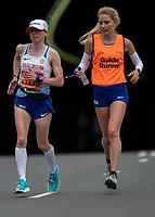 Charlotte Ellis GBR runs with her Guide Runner Lucy Niemz through Blackfriars in the T12 Women World Para Athletics Marathon Championships. The Virgin Money London Marathon, 28 April 2019.<br /> <br /> Photo: Jon Buckle for Virgin Money London Marathon<br /> <br /> For further information: media@londonmarathonevents.co.uk