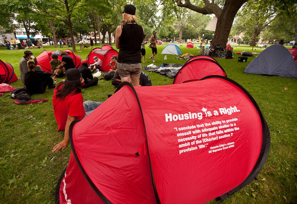 Protesters for the G8 and G20 summits congregate in a tent city which was setup in Allen Gardens, a park at the edge of downtown Toronto, Canada, June 26, 2010. <br /> AFP/GEOFF ROBINS/STR