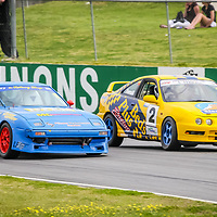 Peter Major (Mazda RX-7) taxing the inside line under brakes into Turn 1 to pass Sean Ferrall (Honda Integra) in a combined Street Car and Improved Production race at the WA State Championship round hosted by the WA Sporting Car Club.