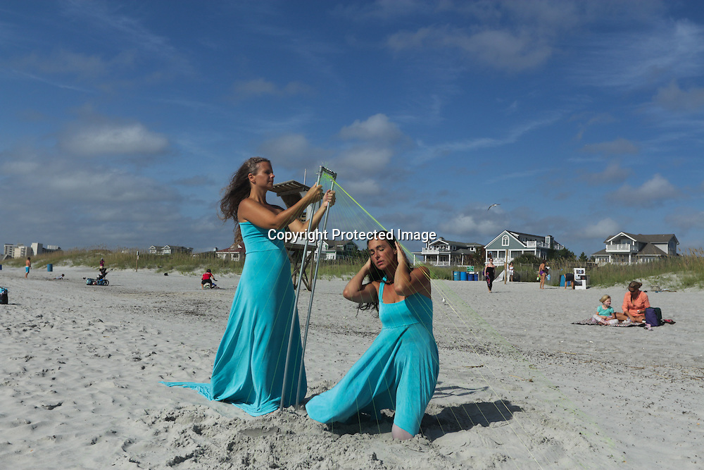 Andi Steele, left, and Andi Trombetta perform during the SARUS Festival Sunday August 24, 2014 at Wrightsville Beach, N.C. (Jason A. Frizzelle)