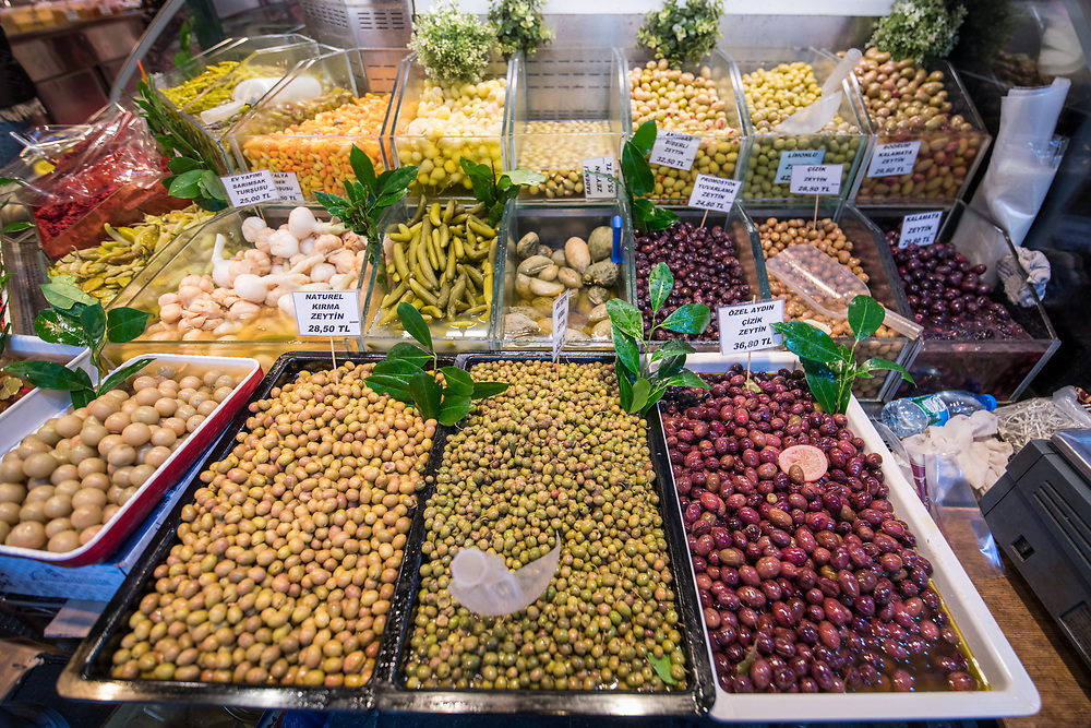 Bin contain a variety of pickled vegetables and olives available for purchase at Istanbul Spice bazaar in Turkey