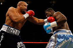October 6, 2007; New York, NY, USA; WBC heavyweight champion Samuel Peter (light blue) and Jameel McCline (dark blue) trade punches during their 12 round bout at Madison Square Garden in New York.  McCline knocked down Peter 3 times, but lost a close unanimous decision.