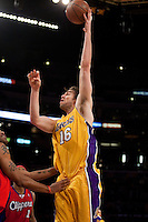 15 January 2010: Forward Pau Gasol of the Los Angeles Lakers shoots the ball while being guarded by Marcus Camby of the Los Angeles Clippers during the second half of the Lakers 126-86 victory over the Clippers at the STAPLES Center in Los Angeles, CA.