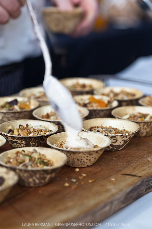 Small bowls of granola with apricot jam and fresh yogurt.
