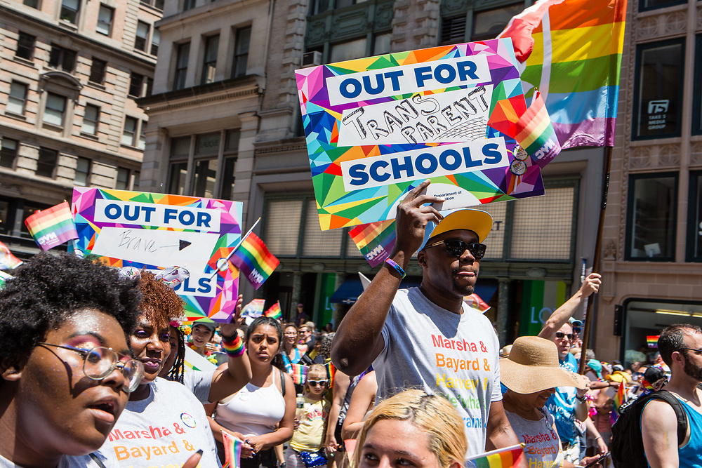 New York, NY - 30 June 2019. The New York City Heritage of Pride March filled Fifth Avenue for hours with participants from the LGBTQ community and it's supporters. Employees of the New York Department of Education carry sgns in support of LGBTQ equality in schools.