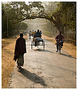 Early morning commuters in the rural village of Shantiniketan. West Bengal, India.