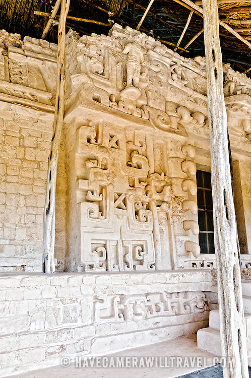 "Ornate carvings on the exterior of the Tomb of Ukit Kan Le'k Tok' at the ancient Mayan ruins at Ek'Balam, near Valladolid, Yucatan, Mexico. The jaguar is a recurring motif, as evidenced by the large stone teeth, etc. Ek' Balam means ""dark jaguar."""