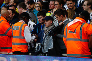 Newcastle United fans are forced to take down a banner that reads 'NEXT EXCUSE PARDEW?' during the Barclays Premier League match at the Emirates Stadium, London<br /> Picture by David Horn/Focus Images Ltd +44 7545 970036<br /> 28/04/2014