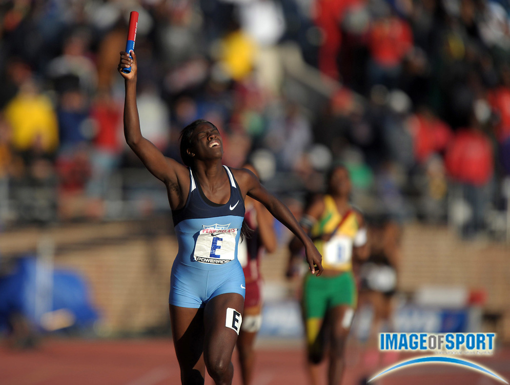 Apr 27, 2012; Philadelphia, PA, USA; Camira Haughton reacts after running the anchor leg on the Edwin Allen (JAM) 4 x 400m relay that won the Championship of America race in 3:42.06 in the 118th Penn Relays at Franklin Field.