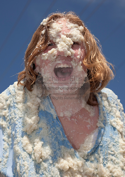 ST GEORGE, SC - APRIL 18: Laura Grimsley, covered in grits after rolling around in a giant vat of grits April 18, 2009 during the World Grits Festival in St. George, SC. Laura won her age group having gathered 29-pounds of grits on her body during the annual event.     (Photo Richard Ellis)