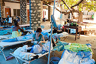 Jill Caporiccio, a volunteer nurse with Project HOPE from Boston, Massachusetts, treats a cholera patient at the Hospital Albert Schweitzer on Thursday, October 28, 2010 in Deschapelles, Haiti.