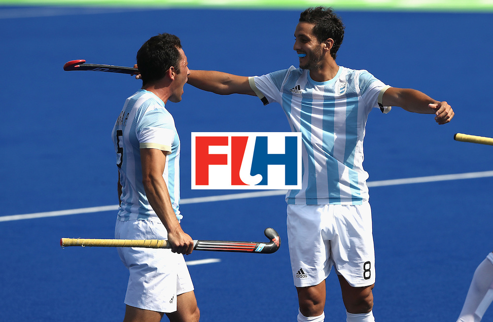 RIO DE JANEIRO, BRAZIL - AUGUST 16:  Pedro Ibarra (L) the Argentina captain, celebrates with Lucas Rey after their 5-2 victory during the Men's semi final hockey match between Argentina and Germany on Day 11 of the Rio 2016 Olympic Games held at the Olympic Hockey Centre on August 16, 2016 in Rio de Janeiro, Brazil.  (Photo by David Rogers/Getty Images)