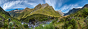 Panorama at the headwaters of the Young River, above Young Hut on the Gillespie Pass Track, in Mount Aspiring National Park, Southern Alps, Otago region, South Island of New Zealand. UNESCO lists Mount Aspiring as part of Wahipounamu - South West New Zealand World Heritage Area. This image was stitched from multiple overlapping photos.