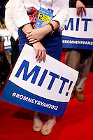 Republican National Convention page holds a Mitt Romney sign at the Tampa Bay Times Forum.