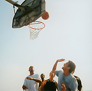 US teenagers playing basketball