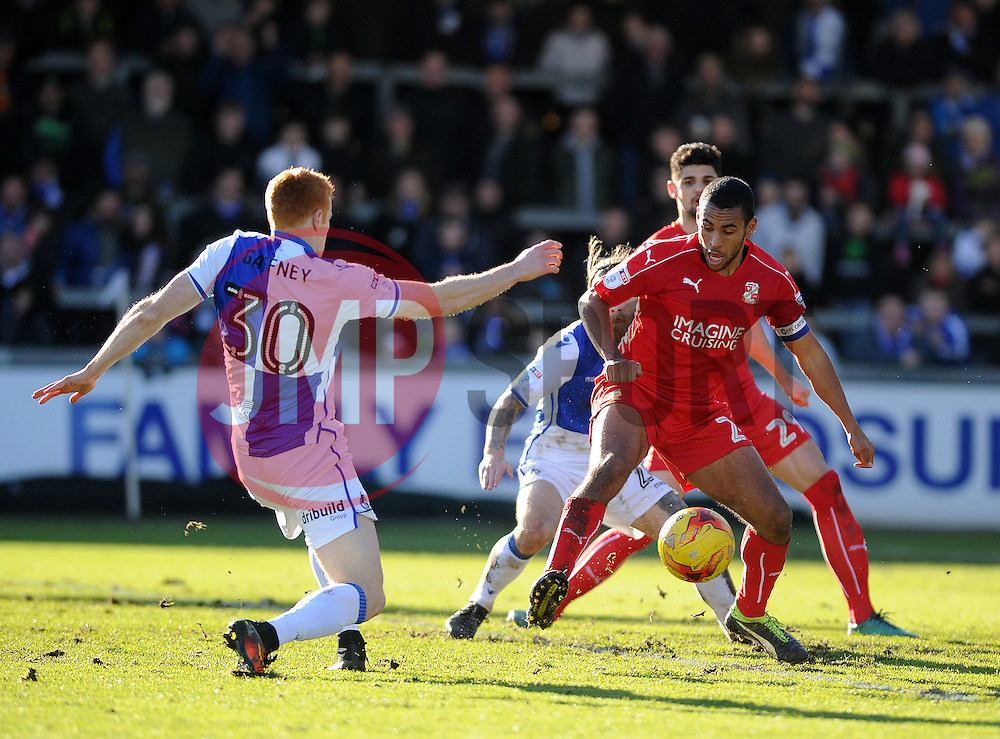 Rory Gaffney of Bristol Rovers is challenged by Nathan Thompson of Swindon Town - Mandatory by-line: Neil Brookman/JMP - 28/01/2017 - FOOTBALL - Memorial Stadium - Bristol, England - Bristol Rovers v Swindon Town - Sky Bet League One