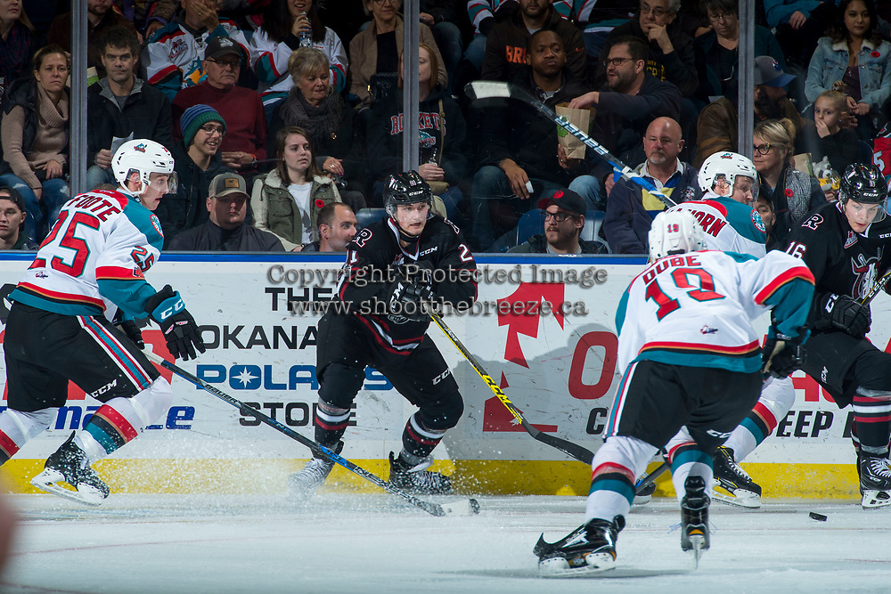 KELOWNA, CANADA - NOVEMBER 11: Kristian Reichel #21 of the Red Deer Rebels passes the puck against the Kelowna Rockets on November 11, 2017 at Prospera Place in Kelowna, British Columbia, Canada.  (Photo by Marissa Baecker/Shoot the Breeze)  *** Local Caption ***