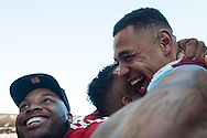 Andre Gray of Burnley celebrates with family following his sides win at the Sky Bet Championship match at Turf Moor, Burnley<br /> Picture by Matt Wilkinson/Focus Images Ltd 07814 960751<br /> 02/05/2016