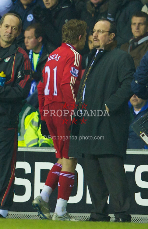 WIGAN, ENGLAND - Monday, March 8, 2010: Liverpool's manager Rafael Benitez substitutes Lucas Leiva during the Premiership match against Wigan Athletic at the DW Stadium. (Photo by David Rawcliffe/Propaganda)