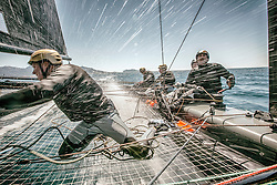 Onboard the GC32 Spindrift. This class is one of the most spectacular sailing classes at the moment, capable of achieving 36 knots. In this shot the boat is doing around 25 with the photographer onboard during a race. <br />