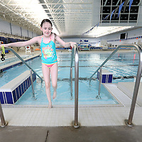 Adam Robison | BUY AT PHOTOS.DJOURNAL.COM<br /> Lily Morris, 8, of Aberdeen, exits the pool at the Aquatic Center during her PE time Tuesday.