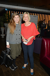 Left to right, AMBER NUTTALL and BEC ASTLEY CLARKE at a party to celebrate the Astley Clarke & Theirworld Charitable Partnership held at Mondrian London, Upper Ground, London on 10th March 2015.