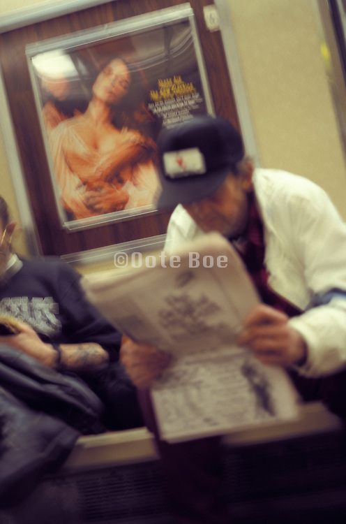 Person reading the newspaper on the subway