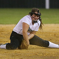 Lauren Wood   Buy at photos.djournal.com<br /> Mooreville's Addie Hitt scoops up the ball during Tuesday night's 3A softball semifinal game against Nettleton. Nettleton defeated Moorville 28-13.