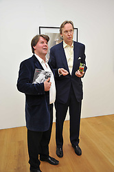 Left to right, BEN BROWN and The HON.JAMES STOURTON at a private view of Alison Jackson's photographs 'Up The Aisle' held at the Ben Brown gallery 12 Brook's Mews, London W1 on 19th April 2011.