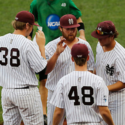 Jun 24, 2013; Omaha, NE, USA; Mississippi State Bulldogs starting pitcher Trevor Fitts (center) is acknowledged by teammates after being removed from the game during the second inning in game 1 of the College World Series finals against the UCLA Bruins at TD Ameritrade Park. Mandatory Credit: Derick E. Hingle-USA TODAY Sports